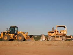 image of two heavy equipment earth movers